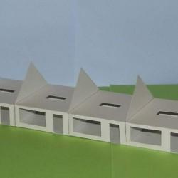 Rijtje van 6 laagbouw woningen in aanbouw in 1:50
