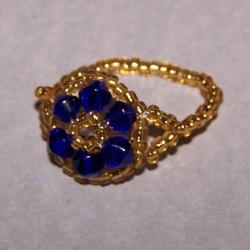 Blauw en goudkleurige kralen ring, maat 18